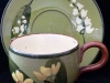 Watcombe Pottery, Cup and Saucer with Lily of the valley and primrose design