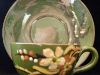 Aller Vale Pottery Cup and Saucer with blossom decoration