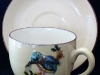 Torquay Pottery Cup and Saucer with applied Bird model
