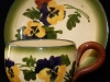 Watcombe Pottery Cup and Saucer with Pansies in Faience pattern