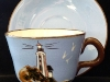 Babbacombe Pottery Cup and Saucer with Lighthouse
