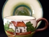 Watcombe Pottery Cup and Saucer with Cottage