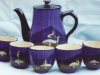 Coffee Set decorated with Pixies, marked 'Made for Herberts' a Daison Art Pottery retailer