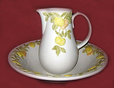 A lime & yellow wash bowl & jug