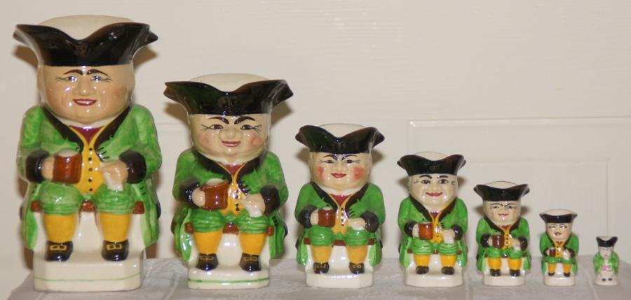 Set of light green Devonmoor Toby Jugs, 8.5