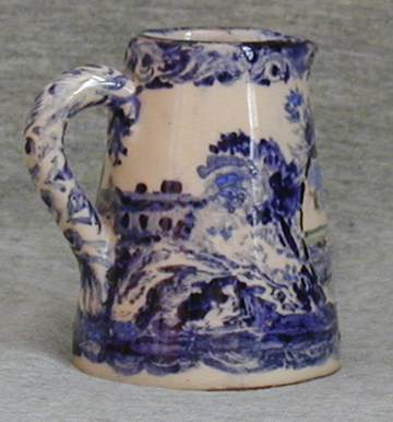Devon Tors small Jug with a Devon scene on stylised Blue and White pattern, side view, brown clay
