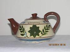 £52 Torquay pottery Teapot with badge of the Devons regiment Dec \'14
