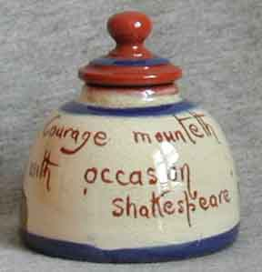 Watcombe Pottery Inkwell, with stopper, decorated with a Cottage, smaller size than standard and with Shakespeare quote