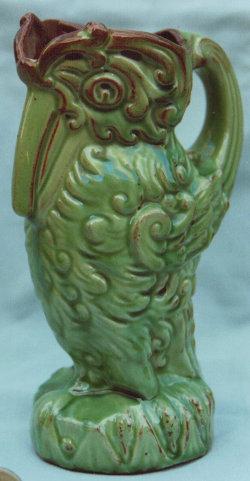 Longpark Art Pottery Jug modelled as a bird , light green ground