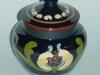 Longpark Pottery Tobacco Jar with art nouveau pattern on green ground