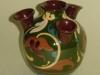 Longpark Pottery Udder Vase with scroll decoration on green ground
