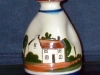 Scent bottle with a cottage