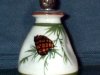 Scent bottle with a pine cone