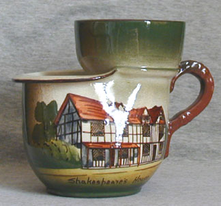 Watcombe Pottery Shaving Mug decorated in the Faience style