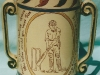 Aller Vale Pottery. Commemorating WG Grace's 100th score of 100 runs or more, which was achieved in 1895. The reverse of this Loving Cup shows crossed cricket bats and a ball.