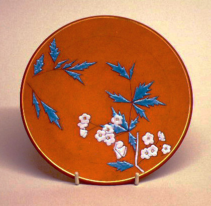 Torquay Terracotta Company. Aesthetic movement enamel decorated plaque in Japanese style.