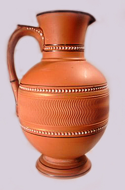 Torquay Terracotta Company. A terracotta ribbed jug.