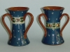 Watcombe Vases with ladybird pattern on blue ground, pattern code N6