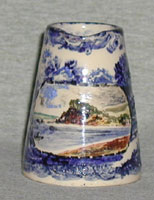 "Devon Tors jug 3"" high in blue and white with coloured cartouche of Devon scene"
